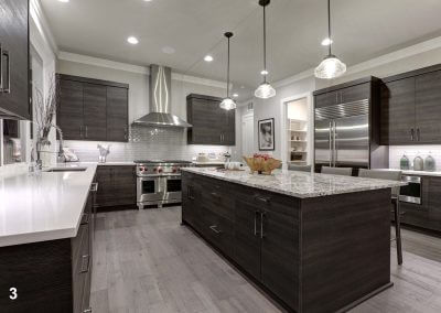 Modern gray kitchen features dark gray flat front cabinets paire